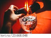 Купить «Ведьма держит горящую свечу, гадание», фото № 23668048, снято 28 августа 2015 г. (c) Яков Чешихин / Фотобанк Лори