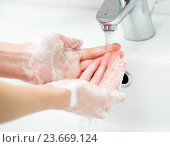 Купить «Washing of female hands with soap in bathroom close up», фото № 23669124, снято 6 декабря 2013 г. (c) Оксана Кузьмина / Фотобанк Лори