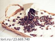 Купить «Кофейные зерна на плетеном подносе», фото № 23669740, снято 3 января 2016 г. (c) Вероника Галкина / Фотобанк Лори
