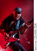 Купить «DNIPROPETROVSK, UKRAINE – OCTOBER 31: Matthias Jabs from Scorpions rock band performs live at Sports Palace SC Meteor. Final tourconcert on October 31, 2012 in DNIPROPETROVSK, UKRAINE», фото № 23693724, снято 31 октября 2012 г. (c) age Fotostock / Фотобанк Лори
