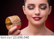 Купить «Woman with golden bracelet in beauty concept», фото № 23696040, снято 14 июля 2016 г. (c) Elnur / Фотобанк Лори