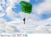 Купить «Single parachute jumper on a wing parachute on blue sky background», фото № 23707136, снято 23 марта 2019 г. (c) FotograFF / Фотобанк Лори