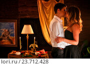Купить «Loving couple kissing in romantic home interior.», фото № 23712428, снято 15 августа 2016 г. (c) Gennadiy Poznyakov / Фотобанк Лори