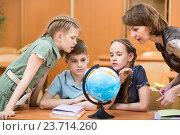 Купить «pupils studying a globe together with teacher», фото № 23714260, снято 11 мая 2013 г. (c) Оксана Кузьмина / Фотобанк Лори