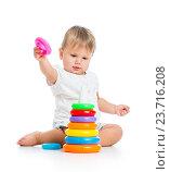 Купить «adorable baby playing with color toy», фото № 23716208, снято 15 сентября 2012 г. (c) Оксана Кузьмина / Фотобанк Лори