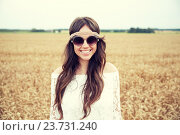 Купить «smiling young hippie woman on cereal field», фото № 23731240, снято 27 августа 2015 г. (c) Syda Productions / Фотобанк Лори