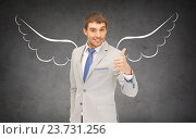 Купить «businessman with angel wings showing thumbs up», фото № 23731256, снято 17 ноября 2018 г. (c) Syda Productions / Фотобанк Лори