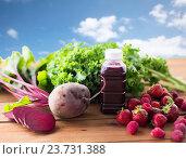 Купить «bottle with beetroot juice, fruits and vegetables», фото № 23731388, снято 5 августа 2016 г. (c) Syda Productions / Фотобанк Лори