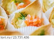Купить «close up of dough cornet with salmon fish filling», фото № 23731436, снято 11 июня 2016 г. (c) Syda Productions / Фотобанк Лори