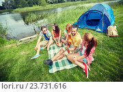 Купить «happy friends with drinks and guitar at camping», фото № 23731616, снято 25 июля 2015 г. (c) Syda Productions / Фотобанк Лори