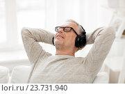 Купить «happy man in headphones listening to music at home», фото № 23731940, снято 7 июля 2016 г. (c) Syda Productions / Фотобанк Лори