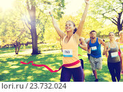 Купить «happy young female runner winning on race finish», фото № 23732024, снято 16 августа 2015 г. (c) Syda Productions / Фотобанк Лори