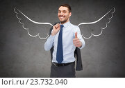 Купить «businessman with angel wings showing thumbs up», фото № 23732040, снято 17 ноября 2018 г. (c) Syda Productions / Фотобанк Лори