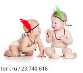 Купить «Two funny little children. Isolated on white background», фото № 23740616, снято 10 февраля 2012 г. (c) Оксана Кузьмина / Фотобанк Лори