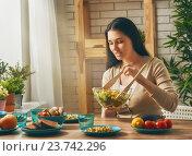 Купить «woman prepares the family dinner», фото № 23742296, снято 21 января 2016 г. (c) Константин Юганов / Фотобанк Лори