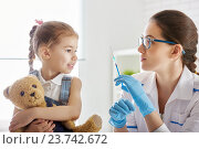 Купить «a vaccination to a child», фото № 23742672, снято 30 ноября 2015 г. (c) Константин Юганов / Фотобанк Лори