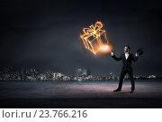 Купить «Businessman demonstrating magic . Mixed media», фото № 23766216, снято 12 марта 2014 г. (c) Sergey Nivens / Фотобанк Лори