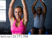 Купить «Smiling female athlete exercising in gym», фото № 23771768, снято 24 апреля 2016 г. (c) Wavebreak Media / Фотобанк Лори