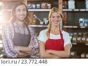 Купить «Smiling staffs standing with arms crossed in supermarket», фото № 23772448, снято 17 мая 2016 г. (c) Wavebreak Media / Фотобанк Лори