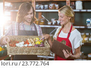 Купить «Male staff holding basket of vegetables and female staff with clipboard», фото № 23772764, снято 17 мая 2016 г. (c) Wavebreak Media / Фотобанк Лори