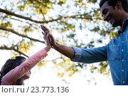 Купить «Father giving high five to his daughter», фото № 23773136, снято 28 июня 2016 г. (c) Wavebreak Media / Фотобанк Лори