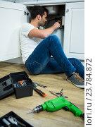 Купить «Man repairing a kitchen sink», фото № 23784872, снято 28 июня 2016 г. (c) Wavebreak Media / Фотобанк Лори