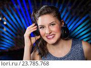 Купить «Pretty female DJ playing music», фото № 23785768, снято 30 июня 2016 г. (c) Wavebreak Media / Фотобанк Лори