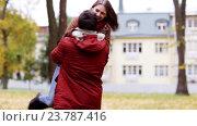 Купить «happy young couple meeting in autumn park», видеоролик № 23787416, снято 12 октября 2016 г. (c) Syda Productions / Фотобанк Лори