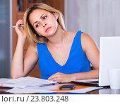 Купить «Exhausted young woman at office», фото № 23803248, снято 20 августа 2018 г. (c) Яков Филимонов / Фотобанк Лори