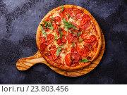 Купить «Пицца с ветчиной и томатами», фото № 23803456, снято 13 октября 2016 г. (c) Лисовская Наталья / Фотобанк Лори