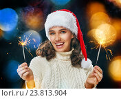 Купить «Beautiful woman holding sparkles.», фото № 23813904, снято 8 ноября 2015 г. (c) Константин Юганов / Фотобанк Лори