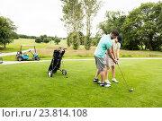 Купить «Male instructor assisting woman in learning golf», фото № 23814108, снято 20 июля 2016 г. (c) Wavebreak Media / Фотобанк Лори