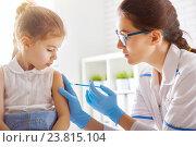 a vaccination to a child. Стоковое фото, фотограф Константин Юганов / Фотобанк Лори