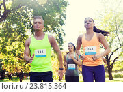 happy young sportsmen racing wit badge numbers. Стоковое фото, фотограф Syda Productions / Фотобанк Лори