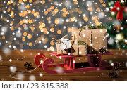 Купить «close up of christmas gift boxes on wooden sleigh», фото № 23815388, снято 7 октября 2015 г. (c) Syda Productions / Фотобанк Лори