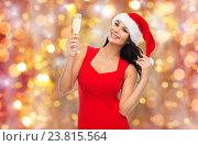 Купить «beautiful sexy woman in santa hat and red dress», фото № 23815564, снято 25 сентября 2015 г. (c) Syda Productions / Фотобанк Лори