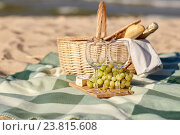 Купить «picnic basket with wine glasses and food on beach», фото № 23815608, снято 18 августа 2015 г. (c) Syda Productions / Фотобанк Лори