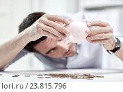Купить «businessman with piggy bank and coins at office», фото № 23815796, снято 18 июня 2015 г. (c) Syda Productions / Фотобанк Лори