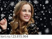 Купить «close up of happy young woman dancing over snow», фото № 23815964, снято 21 ноября 2015 г. (c) Syda Productions / Фотобанк Лори