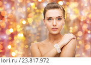 Купить «beautiful woman with pearl earrings and bracelet», фото № 23817972, снято 22 июня 2013 г. (c) Syda Productions / Фотобанк Лори