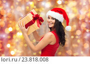 Купить «beautiful sexy woman in santa hat with gift box», фото № 23818008, снято 25 сентября 2015 г. (c) Syda Productions / Фотобанк Лори