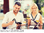 Купить «couple with credit cards paying bill at restaurant», фото № 23818224, снято 15 июля 2015 г. (c) Syda Productions / Фотобанк Лори