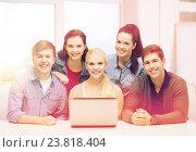 Купить «smiling students with laptop at school», фото № 23818404, снято 2 ноября 2013 г. (c) Syda Productions / Фотобанк Лори