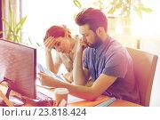 Купить «business team with computer and files in office», фото № 23818424, снято 29 марта 2015 г. (c) Syda Productions / Фотобанк Лори