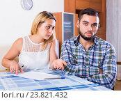 Купить «Couple discussing serious financial situation», фото № 23821432, снято 19 октября 2018 г. (c) Яков Филимонов / Фотобанк Лори