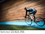 Купить «Athlete on a cycle track», фото № 23823356, снято 12 мая 2016 г. (c) Raev Denis / Фотобанк Лори