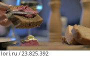 Купить «Close up view of meal table when woman hand spreading pate on wholegrain bread», видеоролик № 23825392, снято 14 августа 2016 г. (c) Данил Руденко / Фотобанк Лори