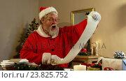 Купить «Santa claus holding scroll», видеоролик № 23825752, снято 29 мая 2020 г. (c) Wavebreak Media / Фотобанк Лори