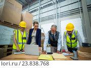 Купить «Warehouse workers and managers working in warehouse», фото № 23838768, снято 23 марта 2016 г. (c) Wavebreak Media / Фотобанк Лори