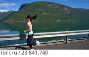 Купить «Woman jogging outdoors», видеоролик № 23841740, снято 17 октября 2016 г. (c) Андрей Армягов / Фотобанк Лори